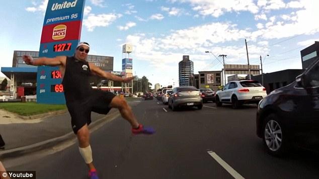 pedestrian tries to kick off cyclist