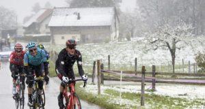 Stefan Kung snowy stage Tour de Romandie