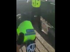 policeman falls off bike