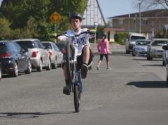teenage cyclist wheelie