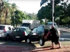Cyclist lifts car out of bike lane