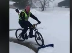 police officer bike shovel snow