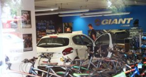 car ploughs into giant bike shop adelaide