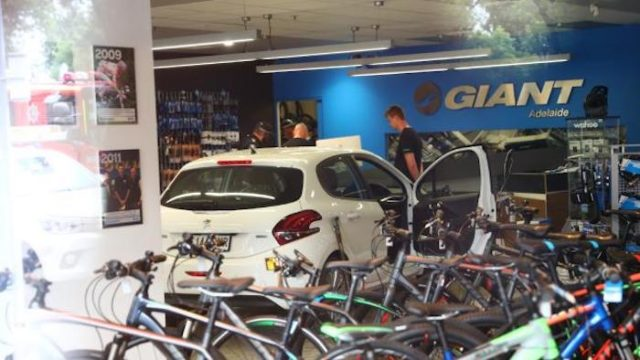 car ploughs into giant bike shop adelaide
