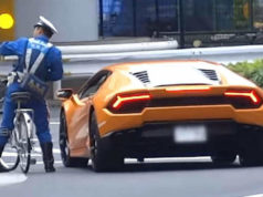 lamborghini driver bicycle cop