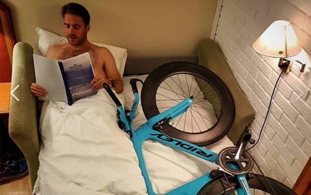 funny cyclist in bed