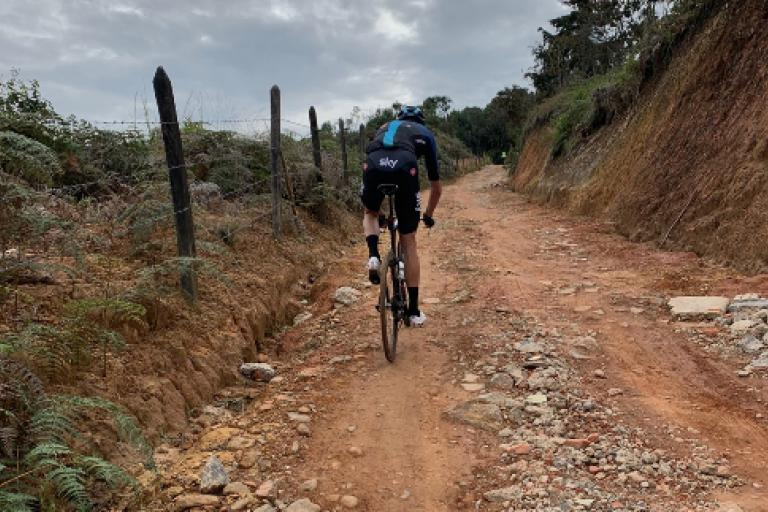 chris froome on time trial bike on gravel roads