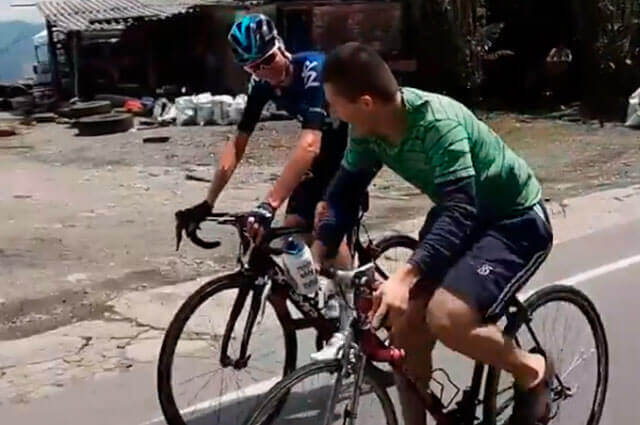 Colombian in Crocs keeps up with Chris Froome on climb